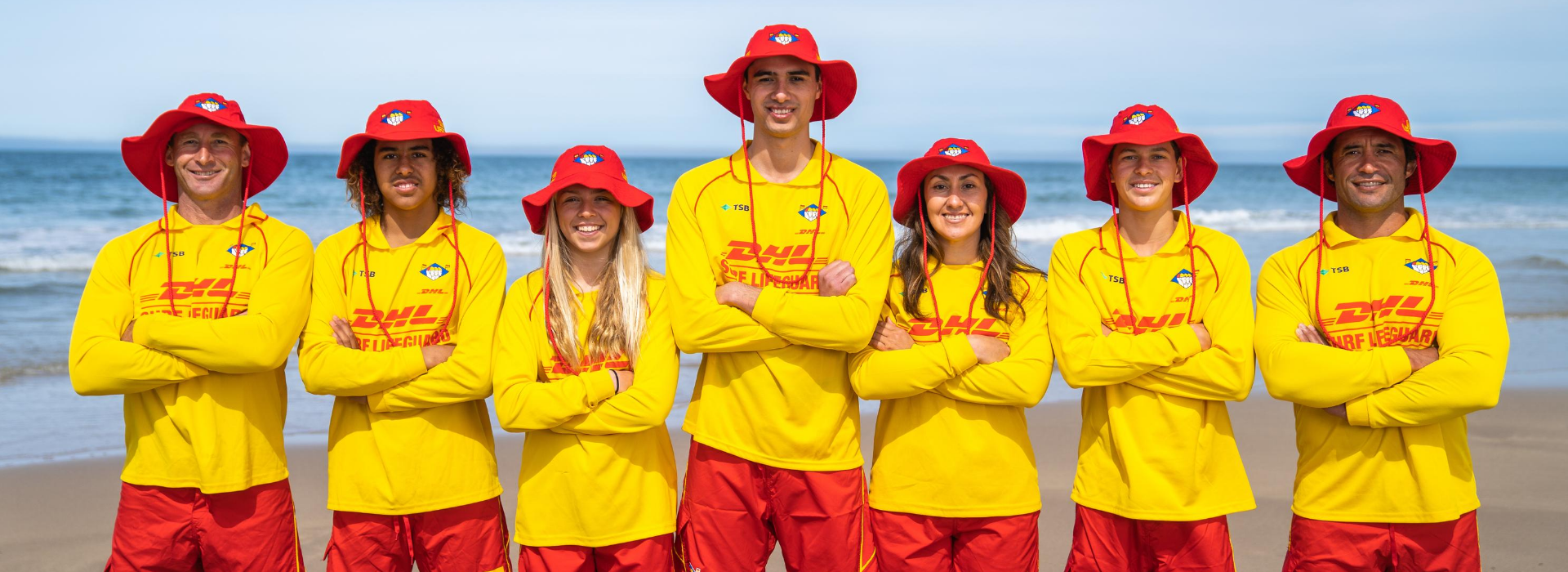Big Group of SLSNZ Lifeguards folding arms