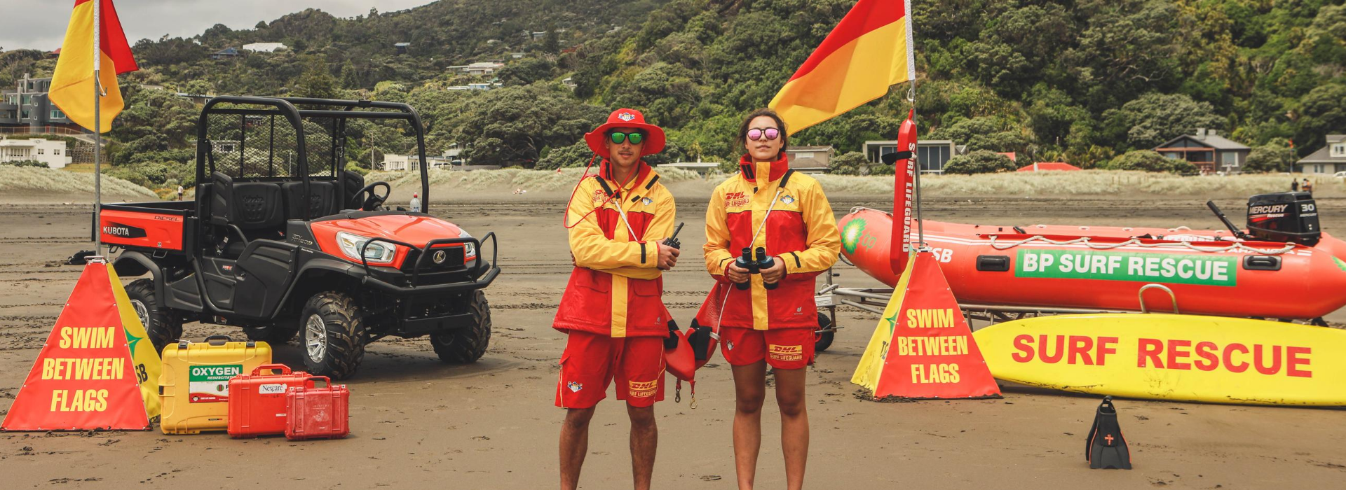 Male Female Lifeguards with all lifesaving equipment 1