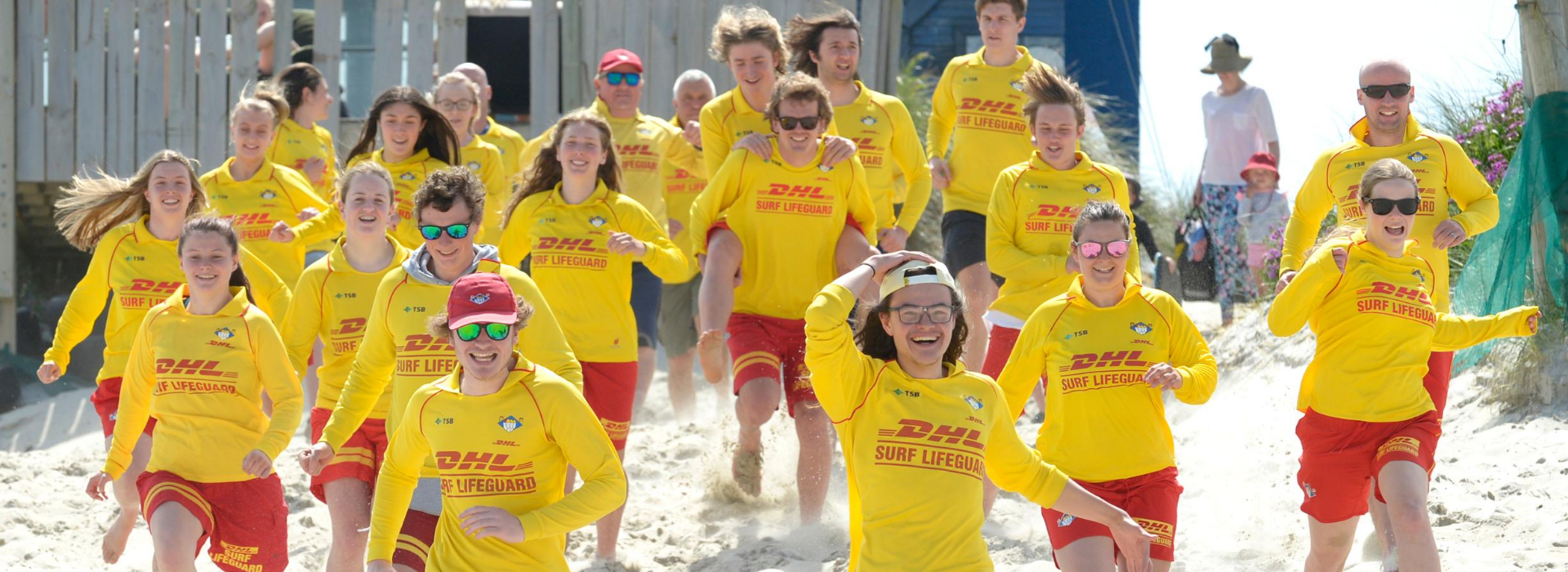 Southern Region Running Happy Lifeguards Shot from Surf Club