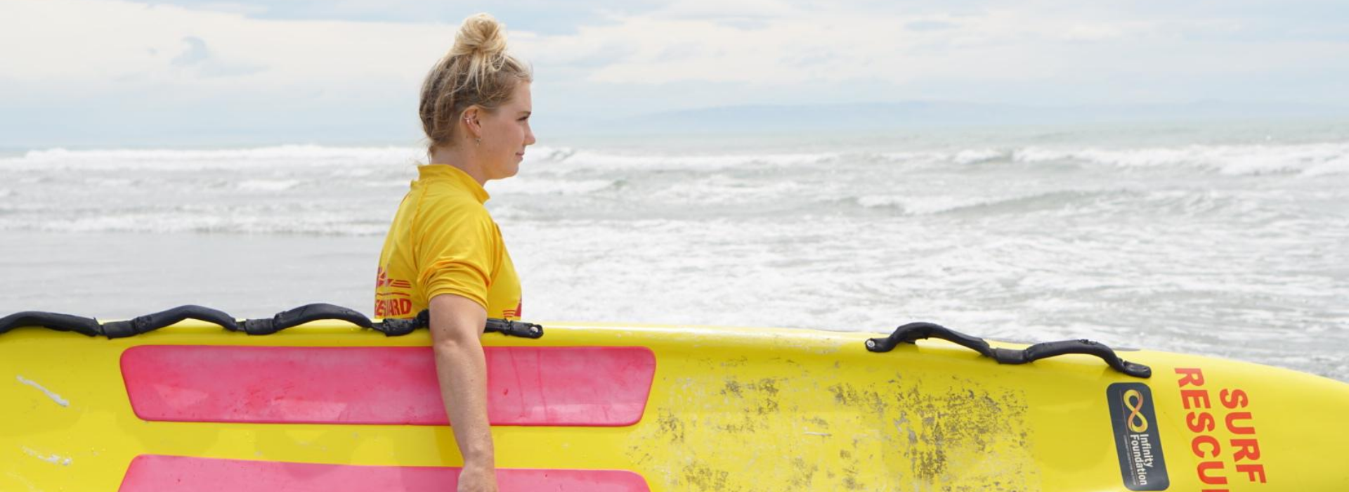 Southern Region Female Lifeguard with Surf Rescue Board