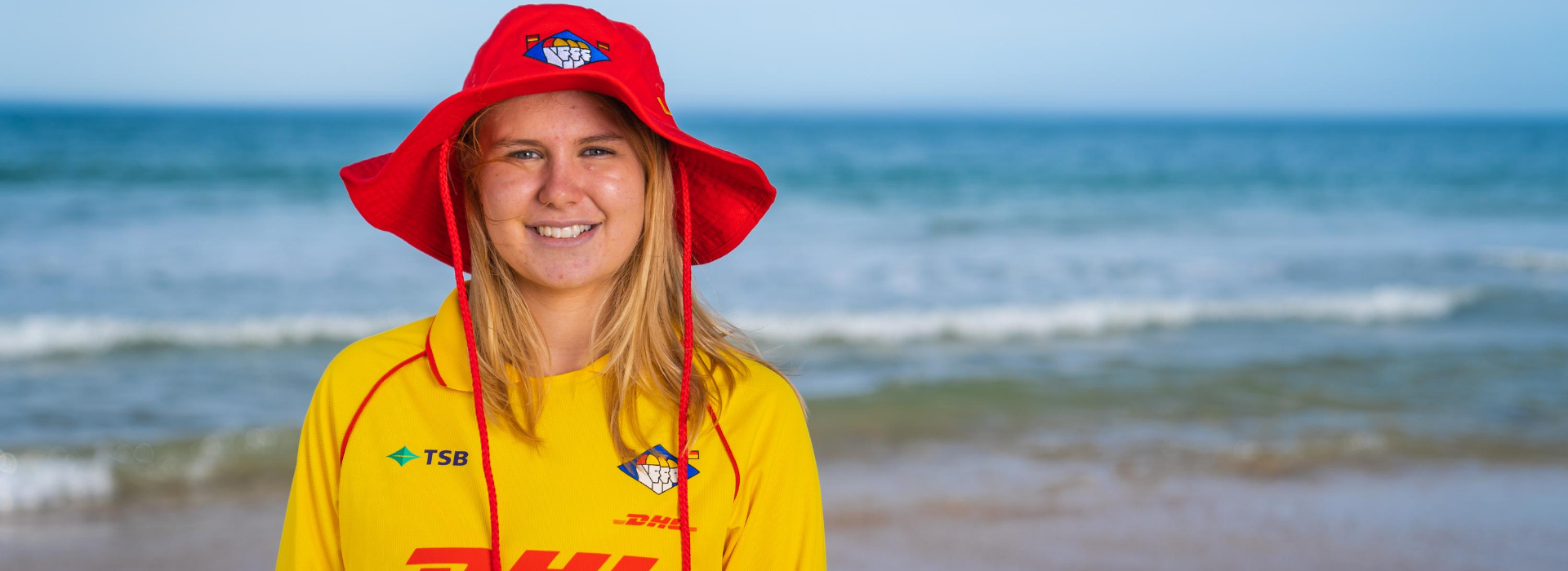 Blonde Surf Lifeguard Facing Shot Smiling with hat
